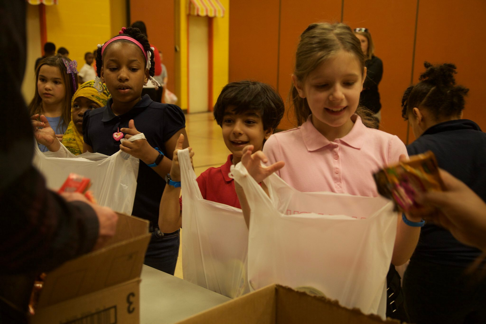 Photo of kids filling their bags with food